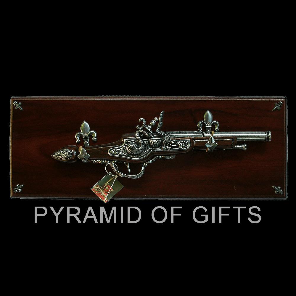 Фото - подарочный пистолет – в настенной рамке - Pyramid Of Gifts